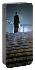 Portable Battery Charger featuring the photograph Man With Case At Night On Stairs by Lee Avison