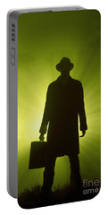 Portable Battery Charger featuring the photograph Man With Case In Green Light by Lee Avison