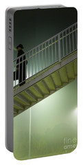Portable Battery Charger featuring the photograph Man With Case On Steps Nighttime by Lee Avison