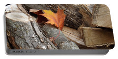 Maple Leaf In Wood Pile Portable Battery Charger