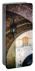 Portable Battery Charger featuring the photograph Medieval Arches With Lamp by Silvia Ganora