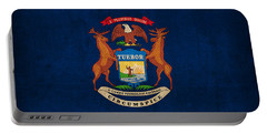 Michigan State Flag Art On Worn Canvas Portable Battery Charger by Design Turnpike