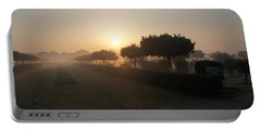 Misty Garden In The Morning Light Portable Battery Charger