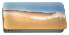 Portable Battery Charger featuring the photograph Misty Yellowstone   by Lars Lentz