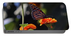 Monarch Butterfly And Orange Zinnias Portable Battery Charger