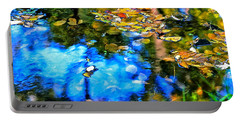 Portable Battery Charger featuring the photograph Monet's Garden by Ira Shander