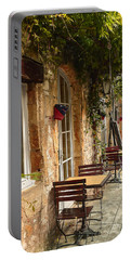 Portable Battery Charger featuring the photograph French Cafe by Dany Lison