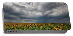 Moody Skies Over The Sunflower Fields Portable Battery Charger