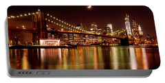 Moon Over The Brooklyn Bridge Portable Battery Charger by Mitchell R Grosky