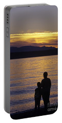 Mother And Daughter Holding Each Other Along Edmonds Beach At Su Portable Battery Charger