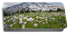 Portable Battery Charger featuring the photograph Mount Rainier And A Meadow Of Aster by Jeff Goulden
