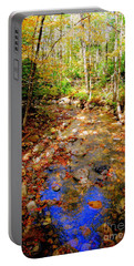 Mountain Stream Covered With Fall Leaves Portable Battery Charger by Eunice Miller
