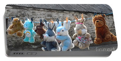 Toys On Washing Line Portable Battery Charger by Nina Ficur Feenan