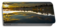 Portable Battery Charger featuring the photograph Naomi Sunset by Gary Keesler