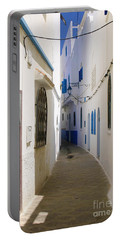 Portable Battery Charger featuring the photograph Narrow Backstreet In The Medina Of Asilah On Northwest Tip Of Atlantic Coast Of Morocco by Ralph A  Ledergerber-Photography