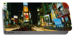 Neon Boards In A City Lit Up At Night Portable Battery Charger