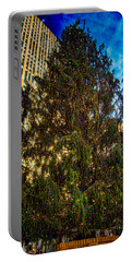 Portable Battery Charger featuring the photograph New York's Holiday Tree by Chris Lord