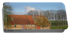 Portable Battery Charger featuring the photograph Normandy Storm Damaged Barn by HEVi FineArt