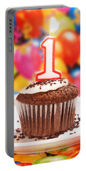 Portable Battery Charger featuring the photograph Chocolate Cupcake With One Burning Candle by Vizual Studio
