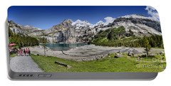 Portable Battery Charger featuring the photograph Oeschinen Lake by Carsten Reisinger