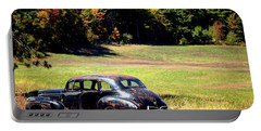 Old Car In A Meadow Portable Battery Charger