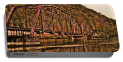 Portable Battery Charger featuring the photograph Old Railroad Bridge With Sepia Tones by Jonny D