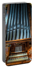 Portable Battery Charger featuring the photograph Olde Church Organ by Adrian Evans