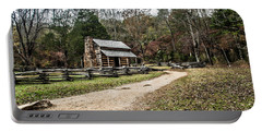 Portable Battery Charger featuring the photograph Oliver's Log Cabin by Debbie Green