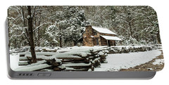 Portable Battery Charger featuring the photograph Oliver's Log Cabin Nestled In Snow by Debbie Green