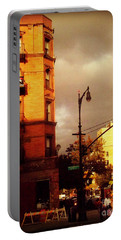 Portable Battery Charger featuring the photograph On The Boulevard by Miriam Danar