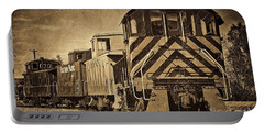 Portable Battery Charger featuring the photograph On The Tracks... Take Two. by Peggy Hughes