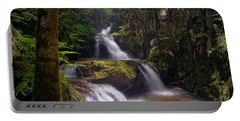 Portable Battery Charger featuring the photograph Onomea Falls by Jim Thompson