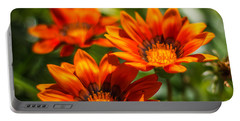 Portable Battery Charger featuring the photograph Orange Flowers by Jane Luxton