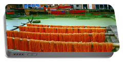 Orange Yarn Portable Battery Charger