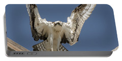 Portable Battery Charger featuring the photograph Osprey Landing by Dale Powell