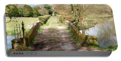 Portable Battery Charger featuring the photograph Over The River by Wendy Wilton