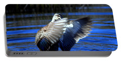 Portable Battery Charger featuring the photograph Pacific Black Duck by Miroslava Jurcik