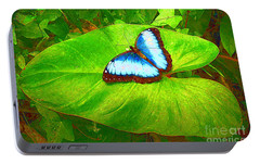 Portable Battery Charger featuring the photograph Painted Blue Morpho by Teresa Zieba