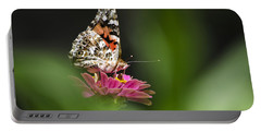 Portable Battery Charger featuring the photograph Painted Lady Butterfly At Rest by Christina Rollo