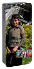 Portable Battery Charger featuring the photograph Pakistani Boy In Front Of Hotel Ruins In Swat Valley by Imran Ahmed