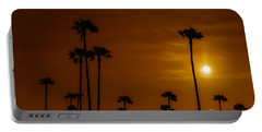 Portable Battery Charger featuring the photograph Palms Silhouettes At Sunset  by David Millenheft