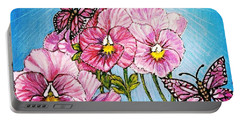 Portable Battery Charger featuring the painting Pansy Pinwheels And The Magical Butterflies With Blue Skies by Kimberlee Baxter