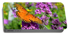 Portable Battery Charger featuring the photograph Passion Butterfly by Deena Stoddard