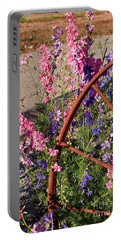 Pastel Colored Larkspur Flowers With Rusty Wagon Wheel Art Prints Portable Battery Charger