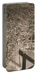 Portable Battery Charger featuring the photograph Peaceful Blizzard by Fiona Kennard