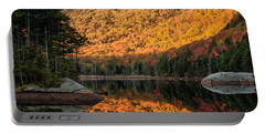 Portable Battery Charger featuring the photograph Peak Fall Foliage On Beaver Pond by Jeff Folger