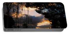 Portable Battery Charger featuring the photograph Peek A Boo Sunset by Janice Westerberg