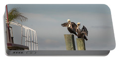 Portable Battery Charger featuring the photograph Pelican Buddies by John M Bailey