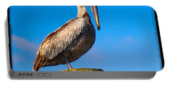 Portable Battery Charger featuring the photograph Pelican by Carsten Reisinger