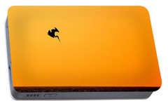 Portable Battery Charger featuring the photograph Pelican Diving At Sunset by AJ  Schibig